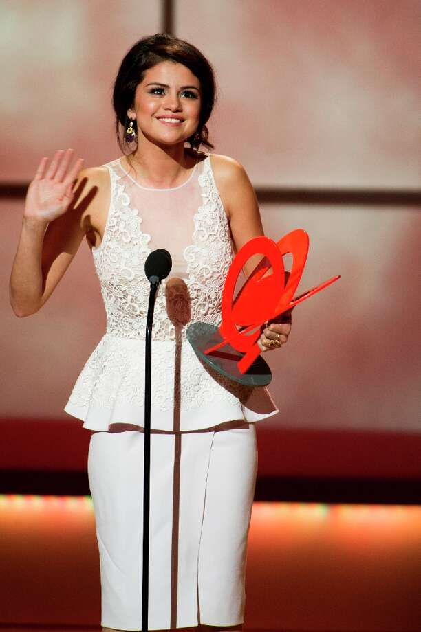 Award recipient Selena Gomez appears onstage at the Glamour Women of the Year Awards on Monday, Nov. 12, 2012 in New York. (Photo by Charles Sykes/Invision/AP) Photo: Charles Sykes, Associated Press / Invision