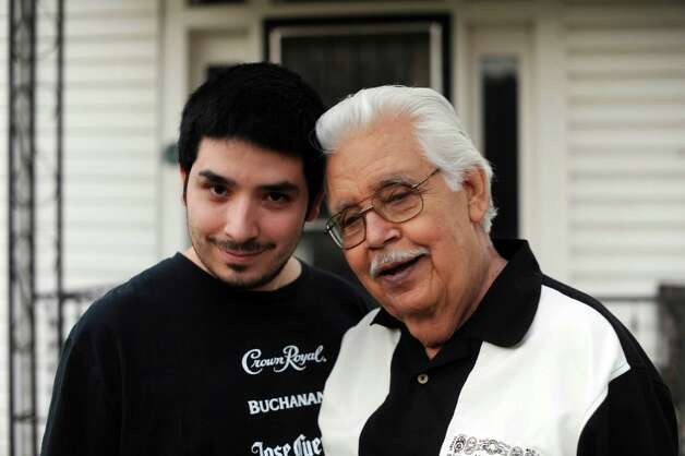 "Jesus ""Chucho"" Perales, who was the guitarist for the rock 'n' roll band Mando & the Chili Peppers, is very close his family. He is shown with his son, Vincent at home on Nov. 8, 2012. Photo: Billy Calzada, Staff / © 2012 San Antonio Express-News"