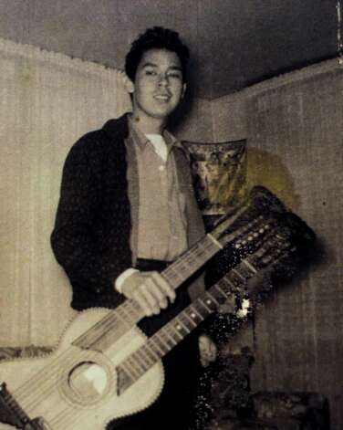 "Jesus ""Chucho"" Perales is shown in a 1957 photo carrying his prize double-neck guitar. He was the guitarist for the band Mando & the Chili Peppers. Photo: HO, Staff / © 2012 San Antonio Express-News"