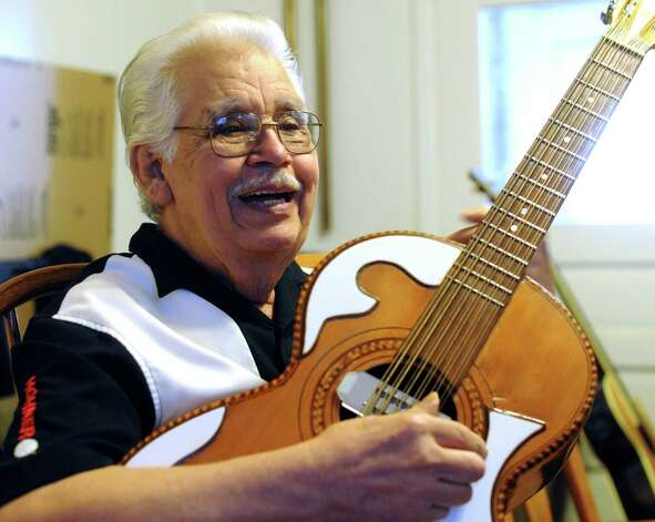 "Jesus ""Chucho"" Perales explains his technique on a bajo sexto. He is the legendary guitarist for Mando & the Chili Peppers. Photo: Billy Calzada, Staff / © 2012 San Antonio Express-News"