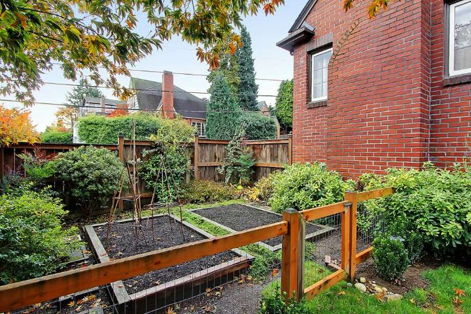 Garden of 1816 N.E. 75th St.. The 2,400-square-foot brick Tudor, built in 1929, has three bedrooms, 1.5 bathrooms, exposed-wood doors and moldings, curved doorways and a brick patio on a 3,393-square-foot lot. It's listed for $450,000, although a sale is pending. Photo: Courtesy Jonathan Savage And Susan Stasik/Windermere Real Estate