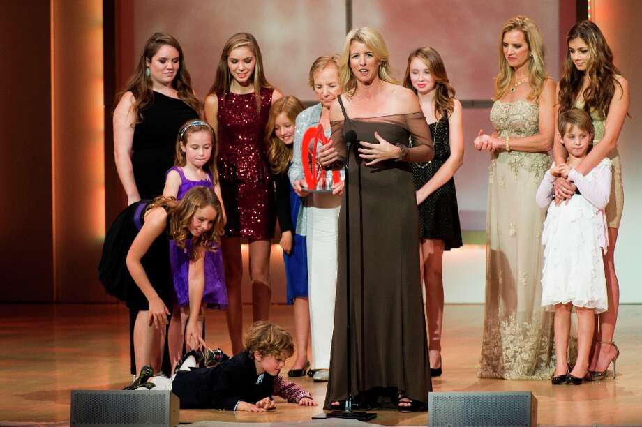 Award recipient Rory Kennedy, center, appears onstage surrounded by Kennedy family members at the Glamour Women of the Year Awards on Monday, Nov. 12, 2012 in New York. (Photo by Charles Sykes/Invision/AP) Photo: Charles Sykes, Associated Press / Invision