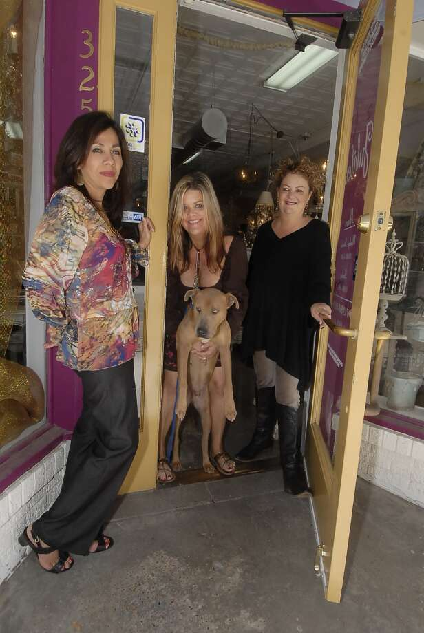 Barrio Dogs event organizers Gloria Zenteno, left,  Jubilee owner Kristal Kirksey and Kelly Simmons meet at the Kirksey's store with Rusty, a rescue dog. Photo:  Tony Bullard 2012, Freelance Photographer / © Tony Bullard & the Houston Chronicle