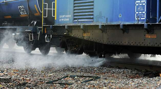 "Due to an especially bad case of ""slippery rail,"" Metro-North power washed the New Canaan Line's rails of slimy leaf residue on Tuesday, Nov. 13, 2012.  The machine, called ""Water World,"" is a switching locomotive followed by two 10,000-gallon tanker cars, followed by the washer/scrubber car which has a compressor and two high pressure nozzles that spray water at 10,000 pounds per square inch onto the top of the rails, followed by another locomotive. Photo: Cathy Zuraw / Stamford Advocate"