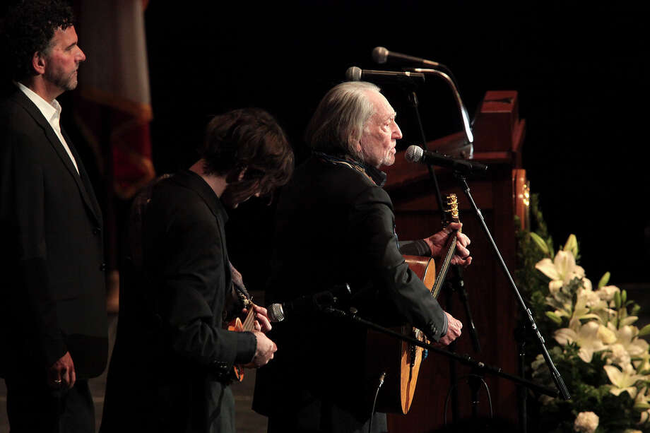 Singer songwriter Willie Nelson performs during the memorial for former University of Texas Football Coach Darrell K Royal at the Frank Erwin Center in Austin, Tuesday, Nov. 12, 2012. Photo: Jerry Lara, San Antonio Express-News / © 2012 San Antonio Express-News