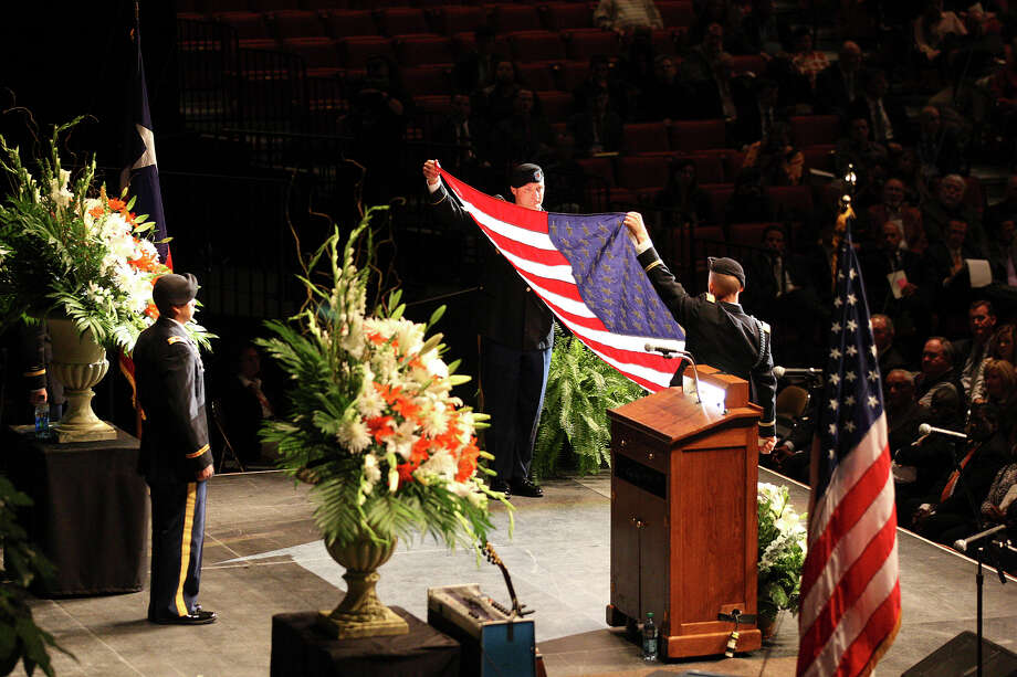 Members of the University of Texas Army ROTC unfurl the flag during the memorial for former University of Texas Football Coach Darrell K Royal at the Frank Erwin Center in Austin, Tuesday, Nov. 12, 2012. Photo: Jerry Lara, San Antonio Express-News / © 2012 San Antonio Express-News