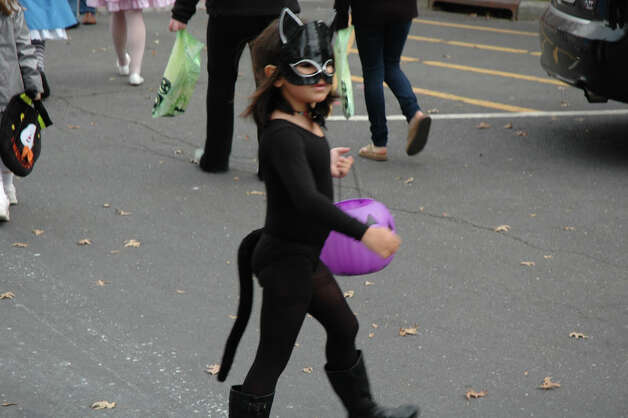 A black cat crosses the street during the 31st annual Halloween Parade, sponsored by the New Canaan Chamber of Commerce, on Sunday, Oct. 28. Photo: Contributed