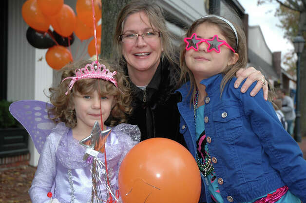 Dawn Lynch and her daughters, Megan, left, and Amber show they are having a good time at the 31st annual Halloween Parade, sponsored by the New Canaan Chamber of Commerce, on Sunday, Oct. 28. Photo: Contributed