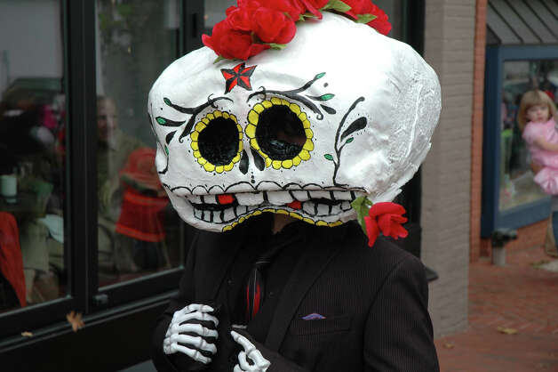 A Dia de Los Muertos-inspired costume is one of the many varied get-ups seen at the 31st annual Halloween Parade, sponsored by the New Canaan Chamber of Commerce, on Sunday, Oct. 28. Photo: Contributed