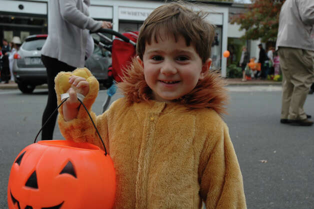 "Levon Keshishian, dressed as a lion, is all smiles after participating in the 31st annual Halloween Parade, sponsored by the New Canaan Chamber of Commerce, on Sunday, Oct. 28. His mother said Levon means ""lion"" in Armenian. Photo: Contributed"