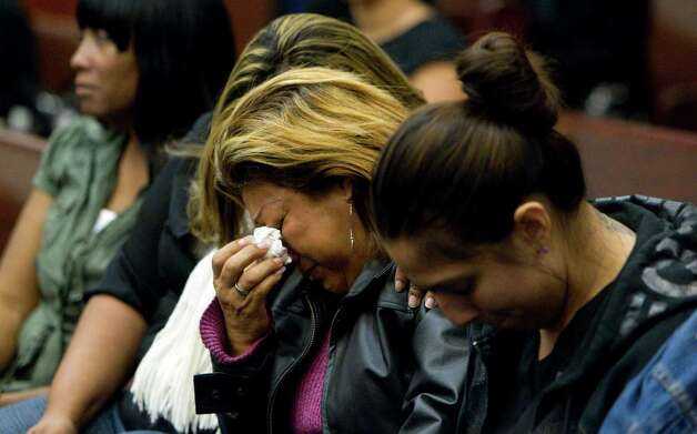 Rosie Castillo, center, grandmother of 16-month-old day care fire victim, Elias Castillo, reacts as home day care operator Jessica Tata was found guilty of murder at the Harris County Criminal Justice Center Monday, Nov. 12, 2012, in Houston. 