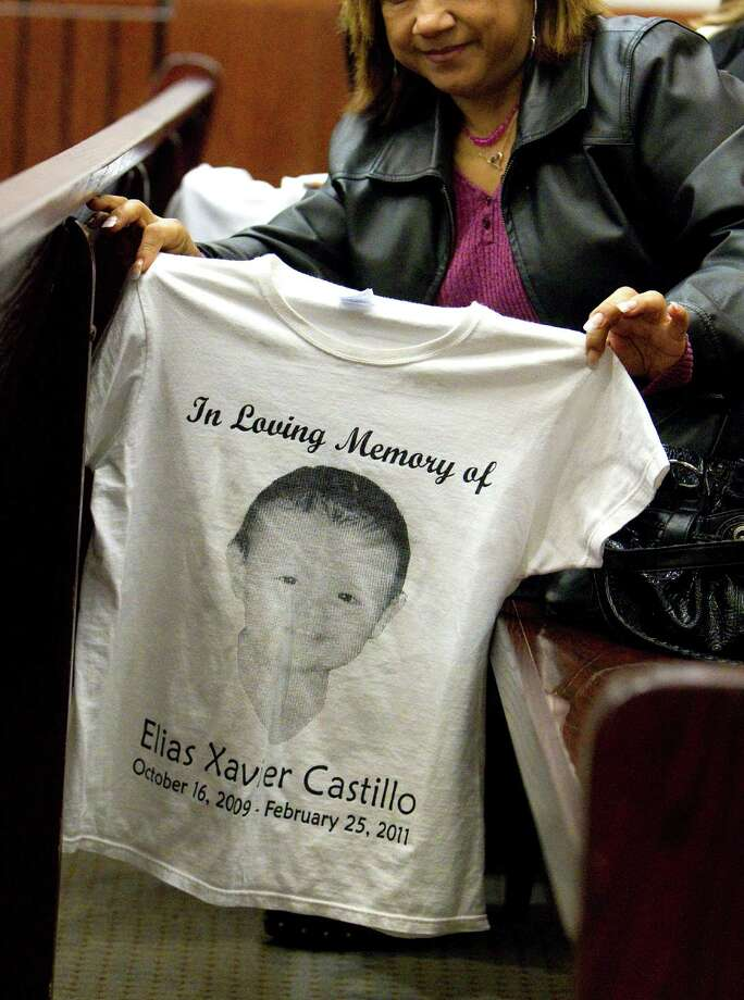 Rosie Castillo, center, grandmother of 16-month-old day care fire victim, Elias Castillo, shows a T-shirt she had made before the home day care operator Jessica Tata was found guilty of murder for his murder at the Harris County Criminal Justice Center Monday, Nov. 12, 2012, in Houston. 