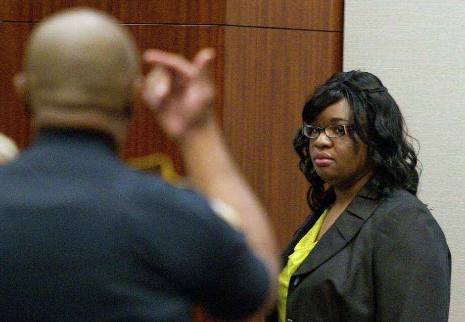 Home day care operator Jessica Tata walks into the courtroom before her verdict was read where she was found guilty for the murder of 16-month-old day care fire victim, Elias Castillo at the Harris County Criminal Justice Center Monday, Nov. 12, 2012, in Houston. 