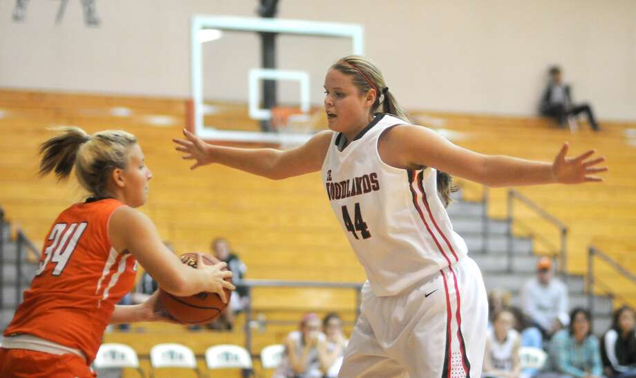 The Woodlands senior post Kelsey Lang pressures LaPorte guard Savannah Riggenbach. Photo: Jerry Baker, Freelance