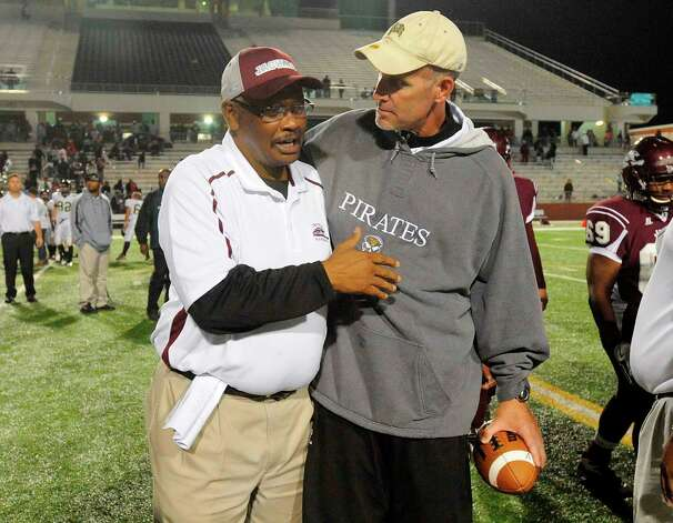 Central head football coach Andrew Washington, left, and Vidor head football coach Jeff Mathews meet at mid filed after the Pirates 28-15 win over the Jaguars at the BISD Thomas Center on Friday. The Pirates played their first game without senior player Matt Thomas, who died after being hit by a train on Sunday.  Friday, October 21, 2011.  Valentino Mauricio/The Enterprise Photo: Valentino Mauricio
