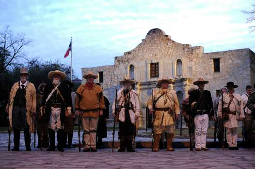 San Antonio Living History Association members playing the part of defenders of the Alamo stand before the Alamo shrine on Saturday, March 6, 2010, the 174th-anniversary of the historic Battle of the Alamo. March 6, 2010. BILLY CALZADA / gcalzada@express-news.net Photo: BILLY CALZADA, SAN ANTONIO EXPRESS-NEWS / gcalzada@express-news.net
