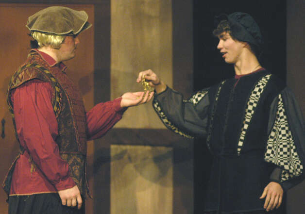"Goldsmith Angelo, played by James Lord of New Milford, mistenly gives a gold chain to Antipholus of Syracuse, played by Harry McDowell of Wilton, during a Nov. 12, 2012 dress rehearsal of Shakespeare's ""The Comedy of Errors."" The play is to be staged Nov. 15 and 16 at 8 p.m. at the New Milford school. Photo: Norm Cummings"