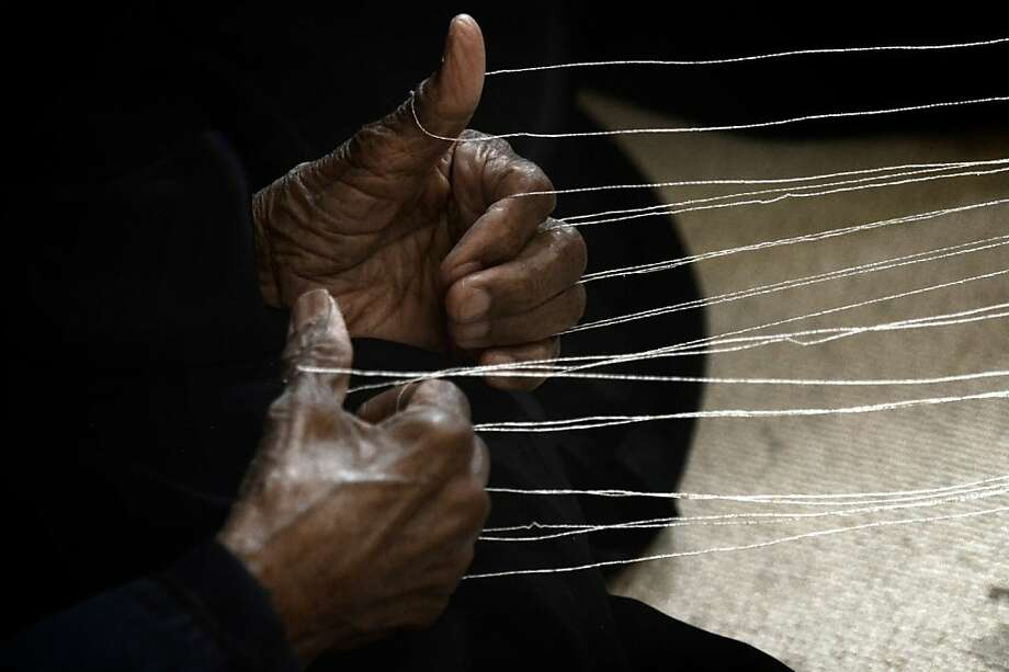 Being all thumbs isn't a bad thing when holding loops of yarn. This woman was putting on a weaving demonstration at the Sheikh Ibrahim Al-Khalifa Cultural Center in Muharreq City, Bahrain. Photo: Mohammed Al-Shaikh, AFP/Getty Images