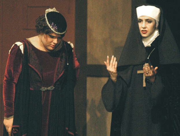 "Lydia Haynes, right, of New Milford portrays the dual role of the Abbess and Aemelia, the mother of long-lost twin boys, as she performs with Loren Winters of Sherman, as Adriana, during a Nov. 12, 2012 dress rehearsal of Shakespeare's ""The Comedy of Errors."" The play is to be staged Nov. 15 and 16 at 8 p.m. at the New Milford school. Photo: Norm Cummings"