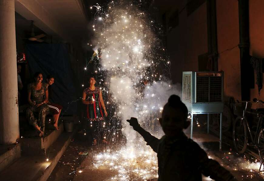 Having a blast: A family sets off firecrackers during Diwali, the festival of lights, in New