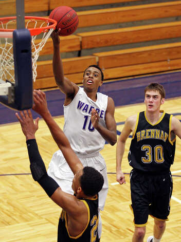 Warren's Paris Collins shoots between Brennan's George King (left) and Brennan's Paul Derkowski during first half action Monday Nov. 12, 2012 at Paul Taylor Field House. Photo: Edward A. Ornelas, San Antonio Express-News / © 2012 San Antonio Express-News