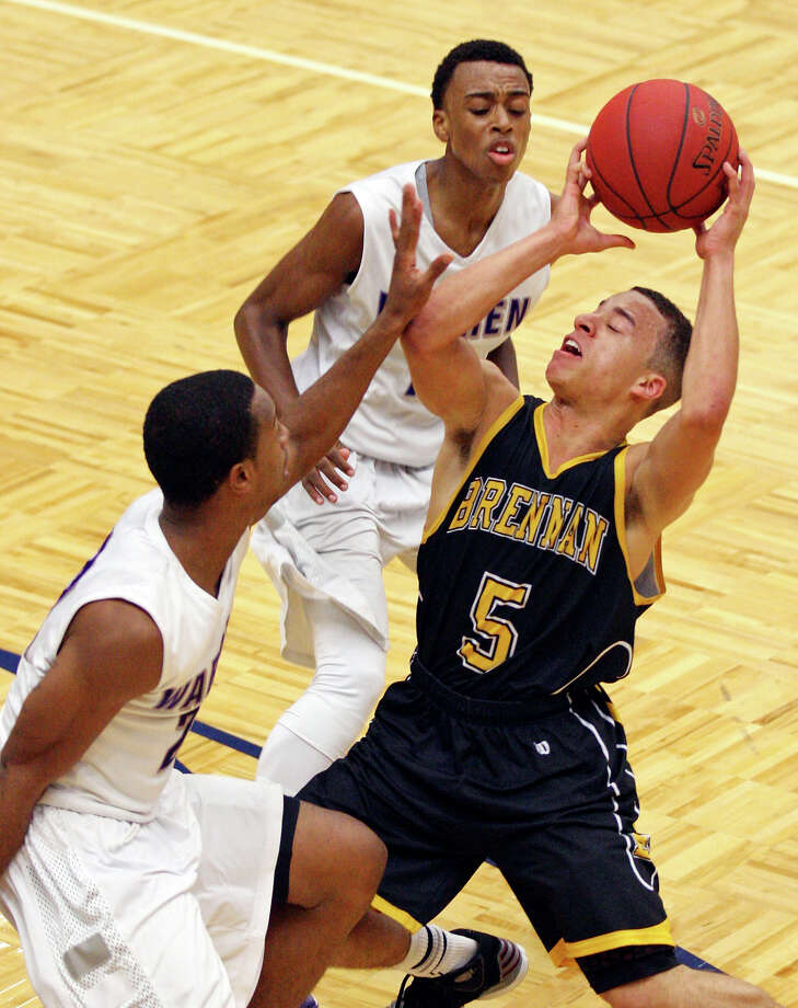 Brennan's Johnny Azzinaro looks for room between Warren's Avionte Sanders and Warren's Paris Collins during second half action earlier this season at Paul Taylor Field House. Photo: Edward A. Ornelas, San Antonio Express-News / © 2012 San Antonio Express-News