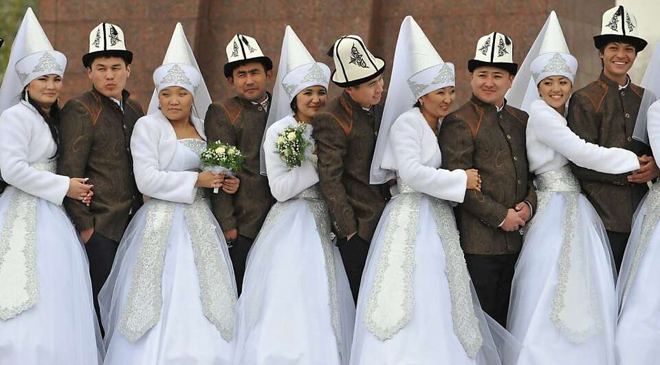 Do you take this pointy headed woman ...? Couples get married in a mass wedding in the Kyrgyz