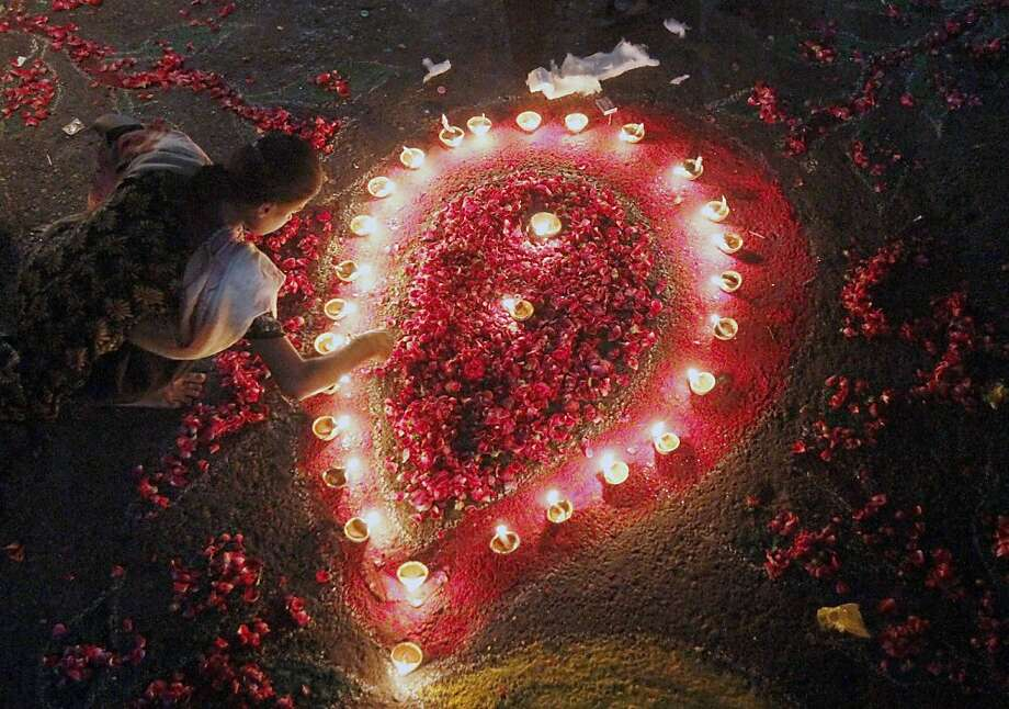 A Pakistani Hindu girl adjusts earthen lamps to decorate an area of her house to celebrate Diwali, the Hindu festival of lights, Tuesday, Nov. 13, 2012 in Karachi, Pakistan. Hindus across the country are celebrating Diwali, where people decorate their homes with light and set off firecrackers. Photo: Shakil Adil, Associated Press