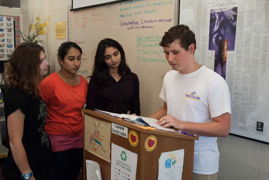 Megan Pearson, 18, g12; Suna Sharma, 16, g11; and Roma Patel, 15, g11, watch as Trevin Kurtanich, 16, g11, practices for a reading at the Kinkaid School.   Photo by R. Clayton McKee Photo: R. Clayton McKee, Freelance / ©2012 R. Clayton McKee