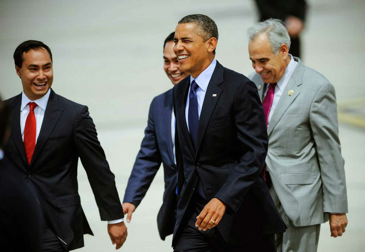 President Barack Obama's walks with from left, Texas State Rep. Joaquin Castro (D), his twin brother San Antonio Mayor Julian Castro and Congressman Charles Gonzalez, upon his arrival Tuesday, July 17, 2012 in San Antonio.