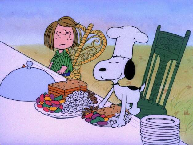 "CHARLIE BROWN THANKSGIVING, A CB_THANKS003 - 'A CHARLIE BROWN THANKSGIVING' - With Thanksgiving coming up, Charlie Brown wants to do something special for the gang. However, the dinner he arranges is a disaster when the caterers, Snoopy and Woodstock, prepare toast and popcorn as the main dish. Humiliated, it will take all of Marcie's persuasive powers to salvage the holiday for Charlie Brown in, 'A Charlie Brown Thanksgiving' airing on FRIDAY, NOVEMBER 16 (8:00-8:30 p.m., ET), on the ABC Television Network. (-1973 United Features Syndicate Inc.)    HOUCHRON CAPTION (11/16/2001):  Peppermint Patty, Snoopy and the rest of the gang prepare for a feast in ""A Charlie Brown Thanksgiving,"" on ABC/Channel 13. Photo: United Features Syndicate / handout web"