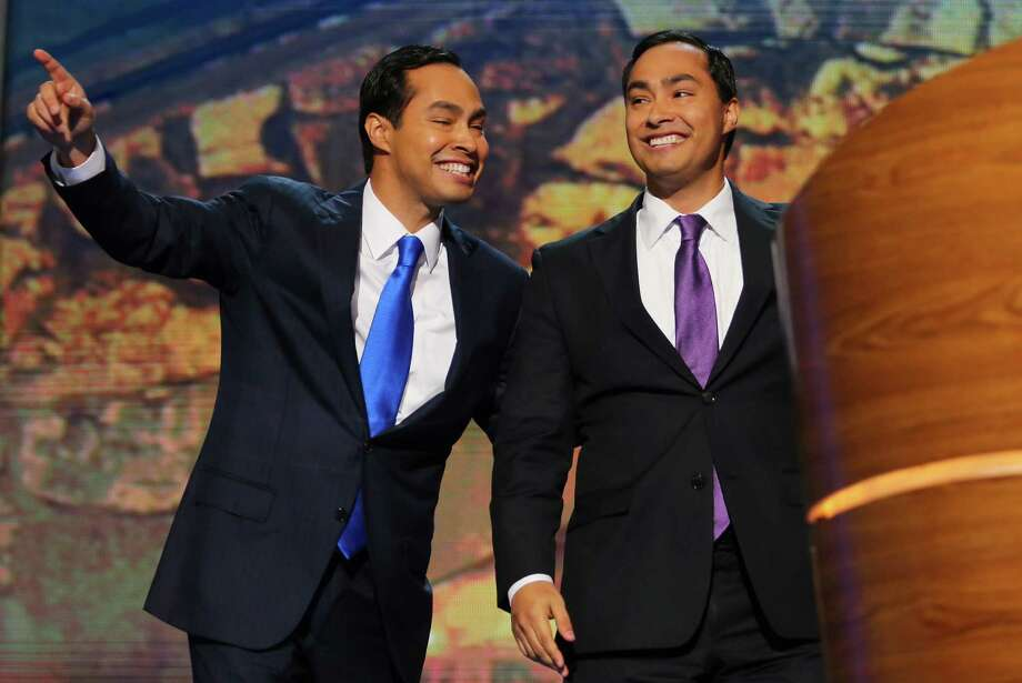 CHARLOTTE, NC - SEPTEMBER 04:  State Rep. Joaquin Castro (D-TX)(R) waves with his brother San Antonio Mayor Julian Castro during day one of the Democratic National Convention at Time Warner Cable Arena on September 4, 2012 in Charlotte, North Carolina. The DNC that will run through September 7, will nominate U.S. President Barack Obama as the Democratic presidential candidate. Photo: Joe Raedle, Getty Images / 2012 Getty Images