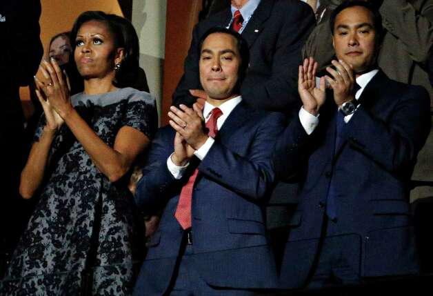 First Lady Michelle Obama, San Antonio Mayor Julian Castro, and his brother, Joaquin Castro, applaud former President Bill Clinton gives his speech on the second night at the 2012 Democratic National Convention at Time Warner Cable Arena, Wednesday, September 5, 2012 in Charlotte, North Carolina. Photo: G.J. McCarthy, McClatchy-Tribune News Service / Harry E. Walker, Copyright 2012