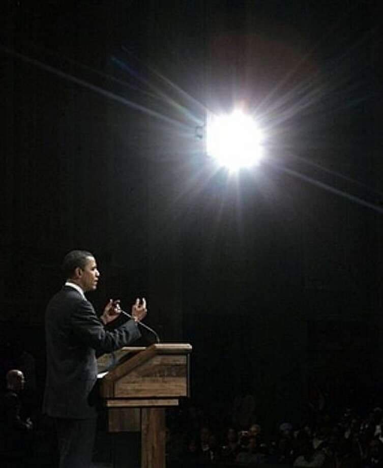 Democratic presidential hopeful Sen. Barack Obama, D-Ill., speaks at a campaign town hall meeting Thursday, Feb. 28, 2008, in Beaumont, Texas. (AP Photo/Rick Bowmer) Photo: Rick Bowmer, AP / AP