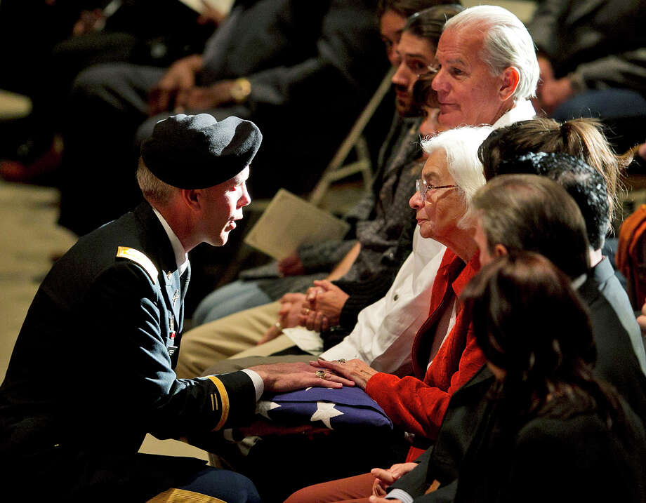 A member of the Texas Army ROTC presents a United States flag to Edith Royal, wife of the late Darrell K. Royal, during a public memorial for Darrell, Tuesday, Nov. 13, 2012, in Austin, Texas. Royal, the coach who led Texas to two national championships and revolutionized college football with the introduction of the wishbone in 1968, died Nov. 7 at age 88. (AP Photo/Statesman.com, Deborah Cannon)  MAGS OUT; NO SALES; INTERNET AND TV MUST CREDIT PHOTOGRAPHER AND STATESMAN.COM Photo: Deborah Cannon, Associated Press / Statesman.com