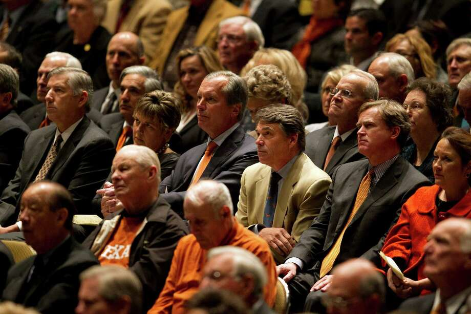 Texas Gov. Rick Perry, third from right, David Dewhurst and others attend a public memorial for former Texas football coach Darrell K Royal, Tuesday, Nov. 13, 2012, in Austin, Texas. Royal, the coach who led Texas to two national championships and revolutionized college football with the introduction of the wishbone in 1968, died on Nov. 7 at age 88.  (AP Photo/Statesman.com, Deborah Cannon)  MAGS OUT; NO SALES; INTERNET AND TV MUST CREDIT PHOTOGRAPHER AND STATESMAN.COM Photo: Deborah Cannon, Associated Press / Statesman.com