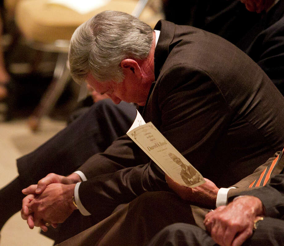 Texas coach Mack Brown bows his head in prayer during a public memorial for former Texas football coach Darrell K. Royal, Tuesday, Nov. 13, 2012, in Austin, Texas. Royal, the coach who led Texas to two national championships and revolutionized college football with the introduction of the wishbone in 1968, died Nov. 7 at age 88.  (AP Photo/Statesman.com, Deborah Cannon)  MAGS OUT; NO SALES; INTERNET AND TV MUST CREDIT PHOTOGRAPHER AND STATESMAN.COM Photo: Deborah Cannon, Associated Press / Statesman.com