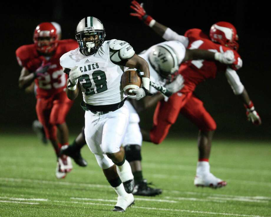 Hightower's Jaquinn Henderson (28) runs the ball upfield during the first half of a high school football game against Dulles, Thursday, October 25, 2012 at Mercer Stadium in Sugar Land TX. (Eric Christian Smith/For the Chronicle) Photo: Eric Christian Smith, Freelance