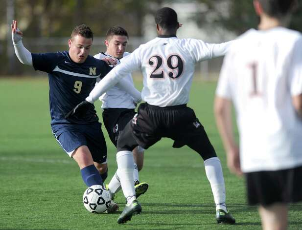 Stamford's Marc Guirand challenges Newington's Justin DeLeo for control of the ball during Tuesday's Class LL quarterfinal soccer game at Stamford High School. Photo: Lindsay Niegelberg / Stamford Advocate