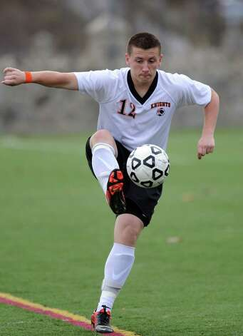 Stamford's Nazar Zhukovsky controls the ball during Tuesday's Class LL quarterfinal soccer game against Newington at Stamford High School. Photo: Lindsay Niegelberg / Stamford Advocate