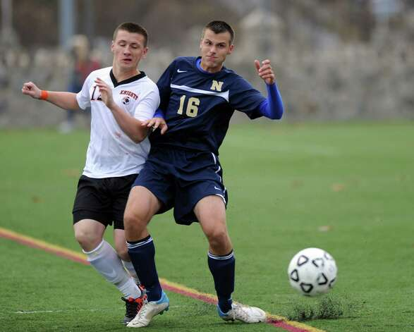 Stamford's Nazar Zhukovsky and Newington's Sasha Tokic compete for control of the ball during Tuesday's Class LL quarterfinal soccer game at Stamford High School. Photo: Lindsay Niegelberg / Stamford Advocate