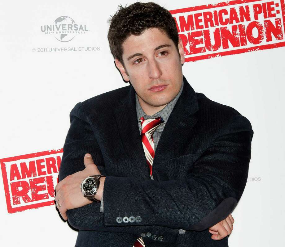 FILE - In this April 16, 2012, file photo, Jason Biggs poses for photographers in London. Biggs is getting some flak for his vulgar tweets, but the actor doesn't seem to mind. Last week, he got into some trouble for tweeting about the wives of the republican presidential candidates. (AP Photo/Jonathan Short, File) Photo: Jonathan Short