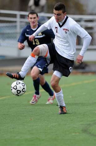 Stamford's Lucas Laria controls the ball during Tuesday's Class LL quarterfinal soccer game against Newington at Stamford High School. Photo: Lindsay Niegelberg / Stamford Advocate