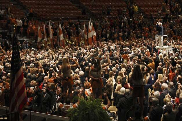 "The University of Texas Longhorn Band performs ""The Eyes of Texas,"" during the memorial for former University of Texas Football Coach Darrell K Royal at the Frank Erwin Center in Austin, Tuesday, Nov. 12, 2012. (San Antonio Express-News)"
