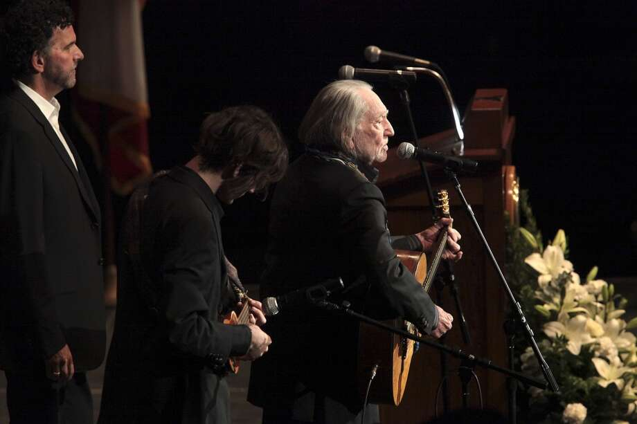 Singer songwriter Willie Nelson performs during the memorial for former University of Texas Football Coach Darrell K Royal at the Frank Erwin Center in Austin, Tuesday, Nov. 12, 2012. (San Antonio Express-News)