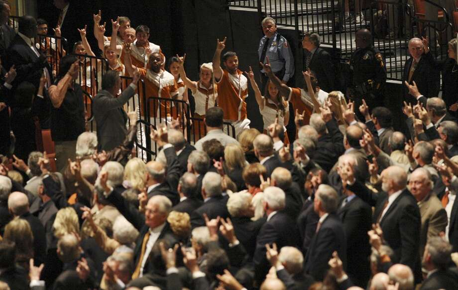 "The University of Texas Cheerleaders join the Longhorn Band before performing, ""The Eyes of Texas,"" during the memorial for former University of Texas Football Coach Darrell K Royal at the Frank Erwin Center in Austin, Tuesday, Nov. 12, 2012. (San Antonio Express-News)"