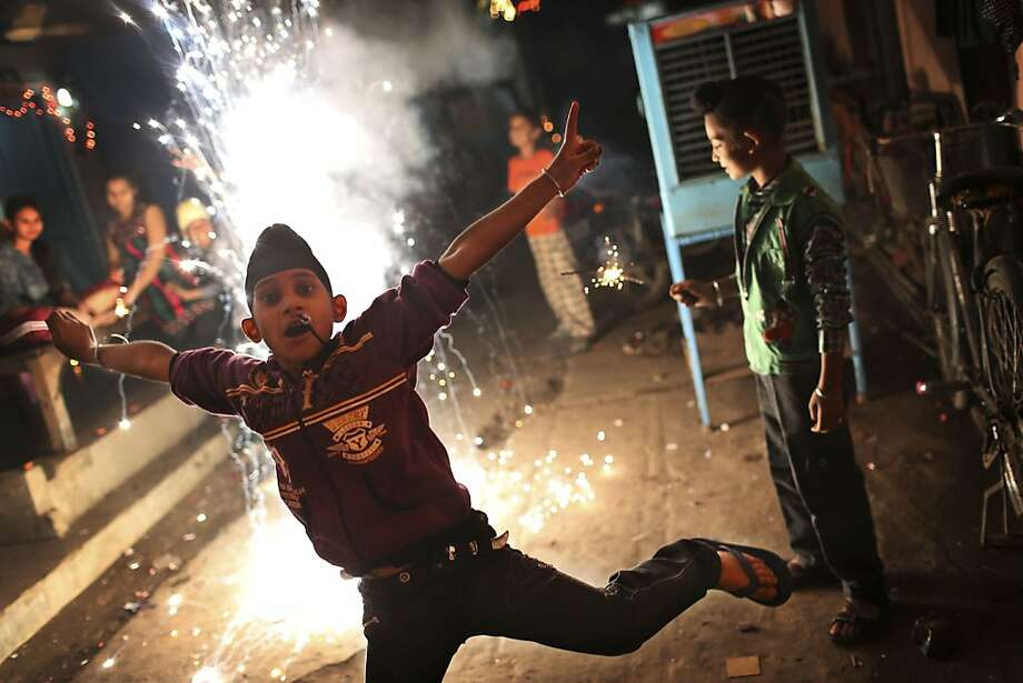 An Indian Sikh boy leaps out of the way of a firecracker as he and friends celebrate the festival of Diwali in New Delhi, India, Tuesday, Nov. 13, 2012. Photo: Kevin Frayer, Associated Press