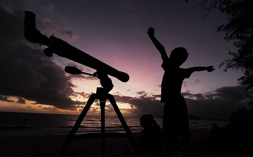 A young boy gets ready to view the solar eclipse  with his telescope on November 14, 2012 in Palm Co