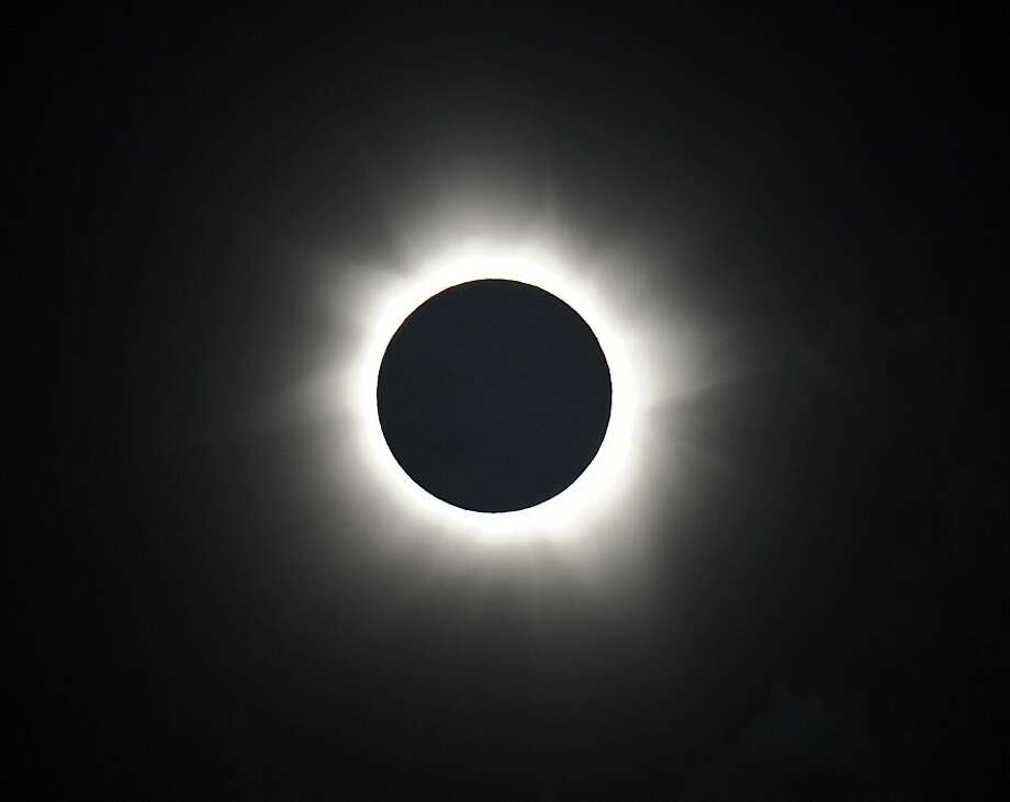 Totality is shown during the solar eclipse at Palm Cove in Australia's Tropical North Queensland on November 14, 2012. Eclipse-hunters have flocked to Queensland's tropical northeast to watch the region's first total solar eclipse in 1,300 years on November 14, which occurred as the moon passed between the earth and the sun, casting a shadow path on the globe and lasting for a maximum on the Australian mainland of 2 minutes and 5 seconds. Photo: Greg Wood, AFP/Getty Images