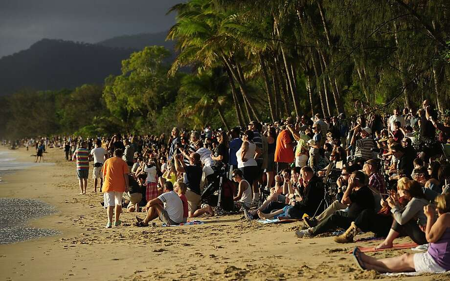 Spectators line the beach to view the total solar eclipse on November 14, 2012 in Palm Cove, Australia. Thousands of eclipse-watchers have gathered in part of North Queensland to enjoy the solar eclipse, the first in Australia in a decade. Photo: Ian Hitchcock, Getty Images